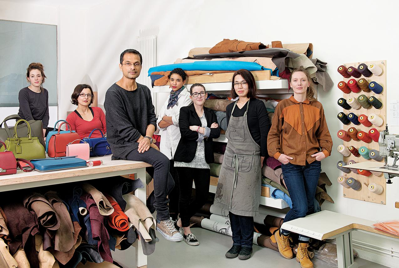 Portrait of Ramesh Nair and his team in Moynat studio.  Rue de la Sourdière, Paris, France . March 23, 2015