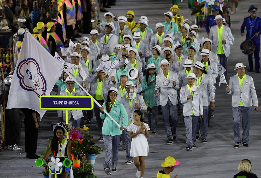 Isheau Wong carries the flag of Taiwan during the opening ceremony for the 2016 Summer Olympics in Rio de Janeiro, Brazil, Friday, Aug. 5, 2016. (AP Photo/Matt Slocum)