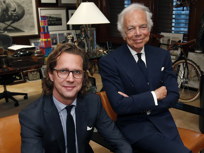 Designer Ralph Lauren, right, poses in his office with Stefan Larsson, global brand president for Old Navy, Tuesday, Sept. 29, 2015, in New York. Lauren is stepping down as CEO of the fashion and home decor empire that he founded nearly 50 years ago, and Larsson, who has been the global president of Gap's low-price Old Navy chain for three years, will succeed him. (AP Photo/Jason DeCrow)