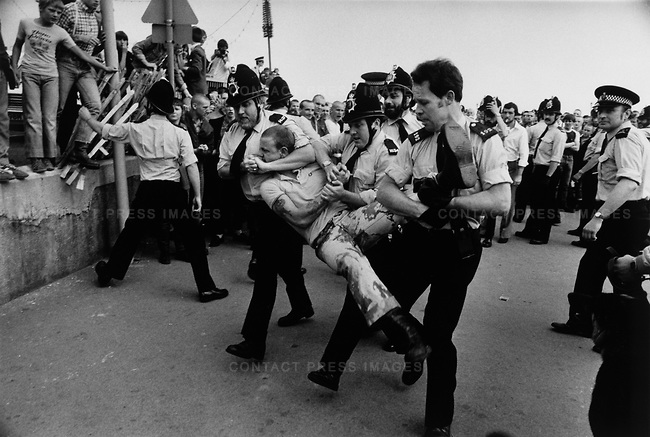 "Police breakup a fight between ""Skinhead"" and ""Mod"" teenagers, Southend, UK, circa 1981"