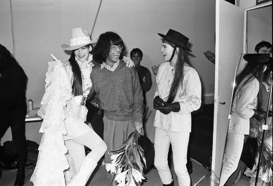 Kenzo Takada enjoying a moment backstage with his models at the end of a fashion show. via Denver Art Museum