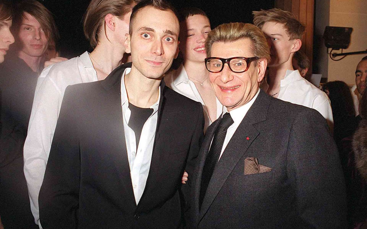 Hedi Slimane and Yves Saint Laurent in 2001 at the Christian Dior Menswear show